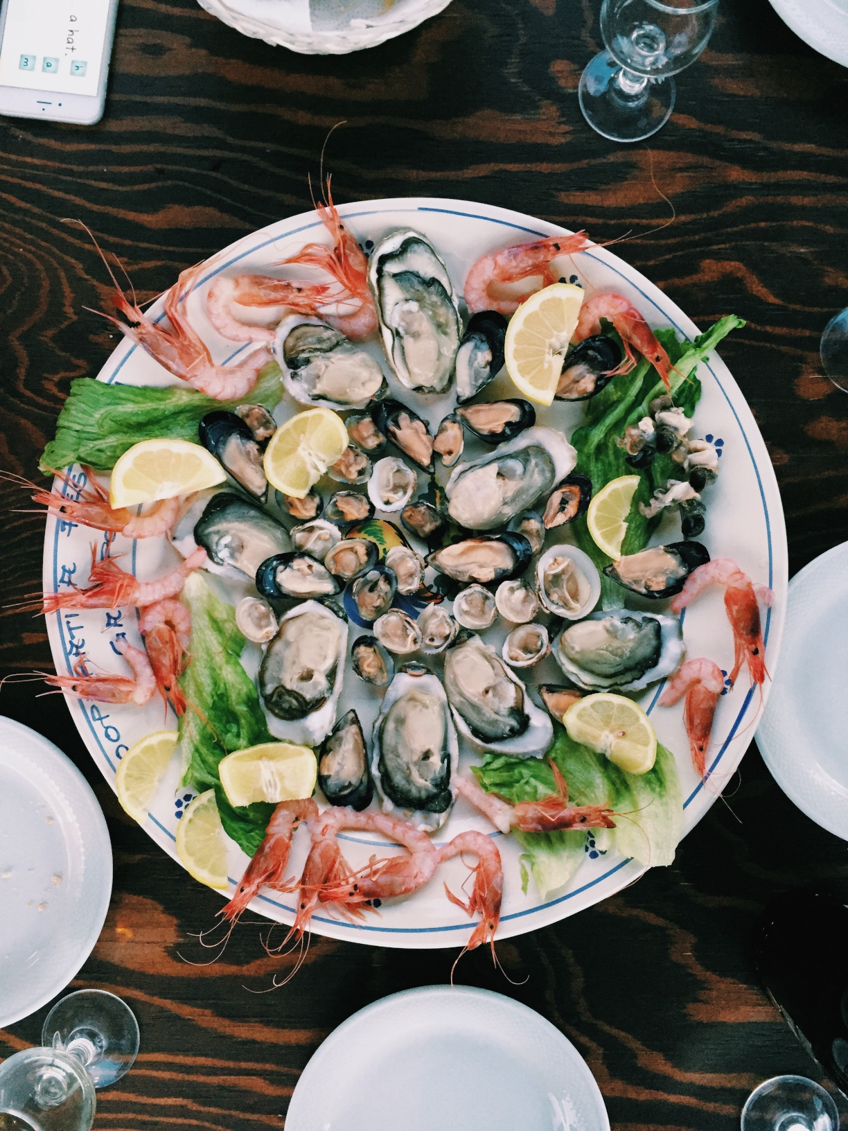 The freshest raw oysters, clams, snails, shrimp, shucked and peeled while you sip cold bubbly.